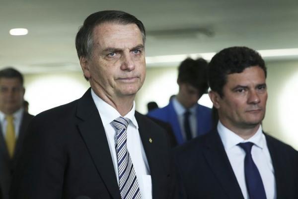 Crédito: Reprodução/Agência BrasilO presidente eleito Jair Bolsonaro e o ministro da Justiça, Sérgio Moro, durante visita ao Superior Tribunal de Justiça (STJ).