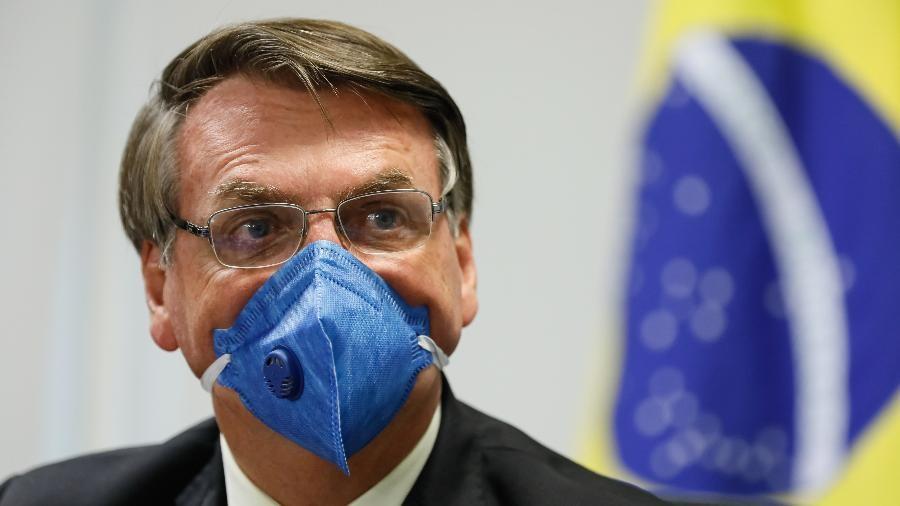 De máscara, presidente Jair Bolsonaro (sem partido) participa de videoconferência com empresáriosImagem: Isac Nóbrega/PR Do UOL, em São Paulo