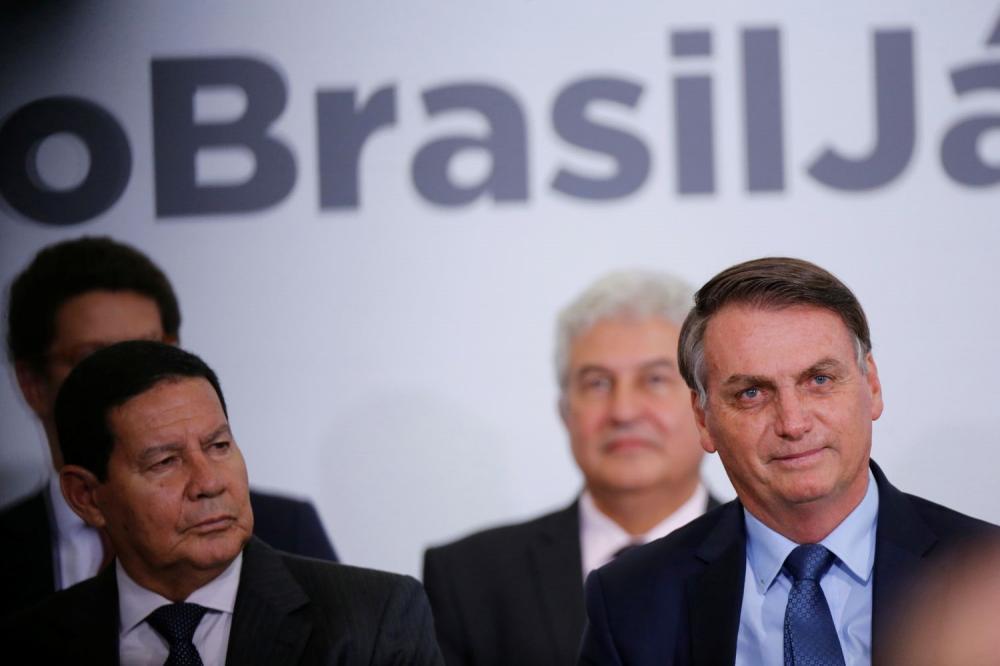 O vice Mourão e o presidente Bolsonaro em 5 fevereiro, no Palácio do Planalto.ADRIANO MACHADO / REUTERS