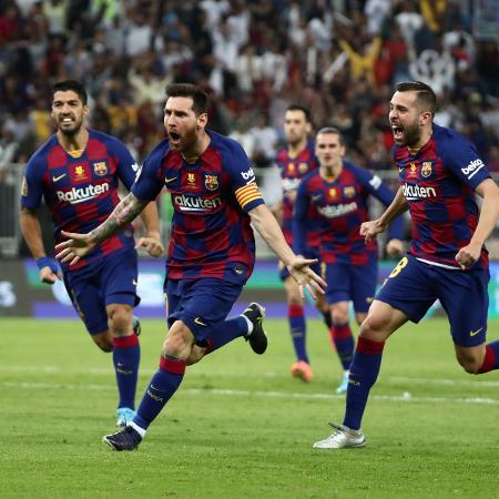 Messi comemora após marcar gol de falta no duelo contra o Atlético de Madri, pela Supercopa da EspanhaImagem: Sergio Perez/Reuters